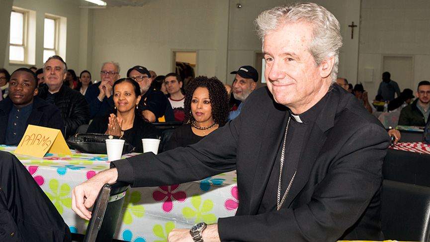 Archbishop Lépine listening to the refugees sponsored by the diocese, on April 6, 2019.