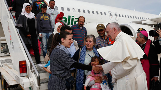 Pope prays for refugees, brings 12 Syrians back to Rome