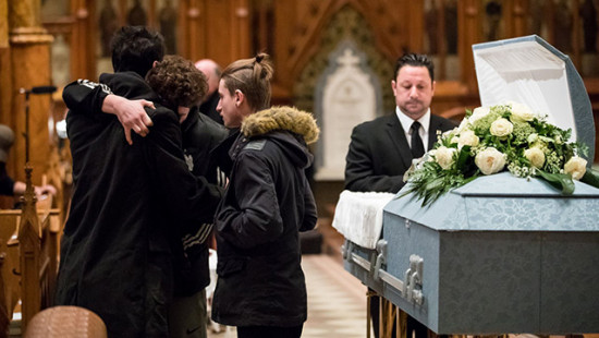 Young people in in front of Father Emmett Johns Pops juste before the Funeral Mass at Saint Patrick's Basilica